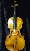 Images of a 16 inch viola made in 1937 in Versailles by Marcel Deloget. Viola has a lovely French oil varnish.