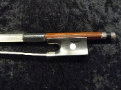Images of a full size violin bow made in China by the Jacques Remy factory. The bow is made of brazilwood and has a solid ebony frog with a pearl eye and the Remy stamp.