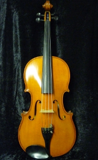 "Images of the 16 inch ""Rappoldi"" viola, made in Germany and imported into the U.S.A. by William Lewis & Son in 1994. The images show the front, back, scroll, and label of this nice, intermediate level viola."
