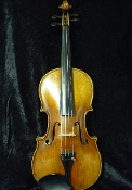 Images of a 3/4 violin made by Franz Schubert. This little violin is hand-carved and has a lovely brown varnish.