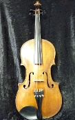 Images of a 15 and 1/8 inch viola made somewhere in Europe approximately 100 years ago. Viola has lovely varnish and sound. No label image is shown as viola has no label.