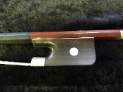 Images of a 3/4 bass bow made by Czech company of Jan Dvorak. Bow has pernambuco wood and a French style ebony frog.