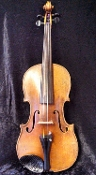 Images of a nice 15 and 1/4 inch German viola. The maker of this viola is unknown, but it was made around 1930.